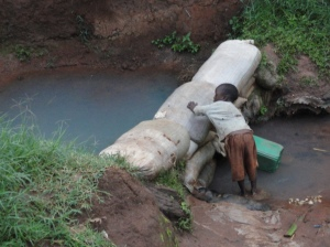 Boy getting drinking water in Kenya