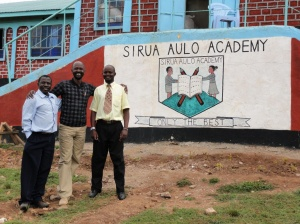 Joshua, Emmanuel, and the headmaster