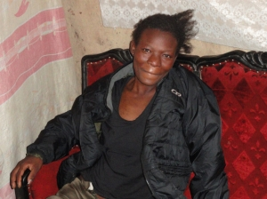 Woman in slums enjoying her new jacket