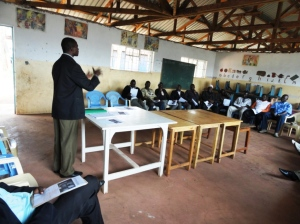 Steve presenting at the Kibera community meeting